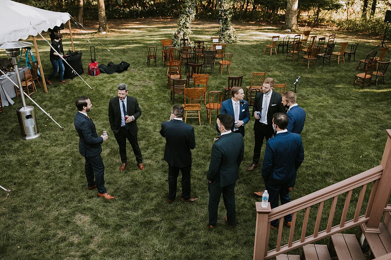 Groomsmen talking before wedding