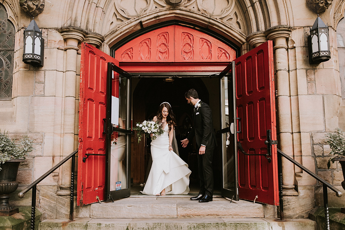 Bride and groom walking out of Pittsburgh church