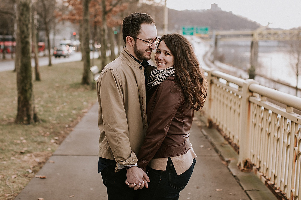 Couple smiling downtown Pittsburgh