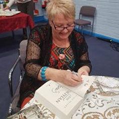 me signin g books.jpg