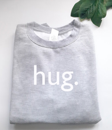 hug. Sweatshirt