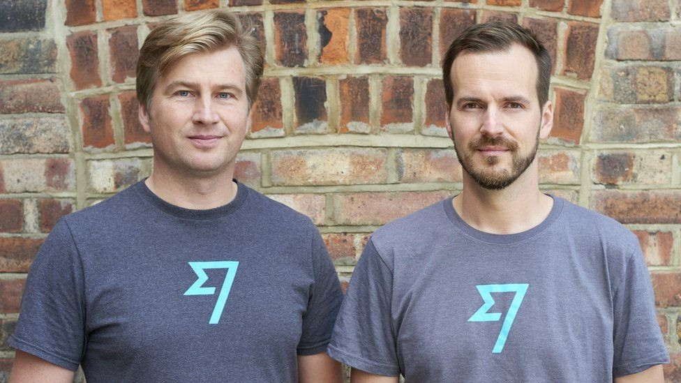 Kristo Käärmann and Taavet Hinrikus, Co-Founders of Wise, standing in front of a brick wall