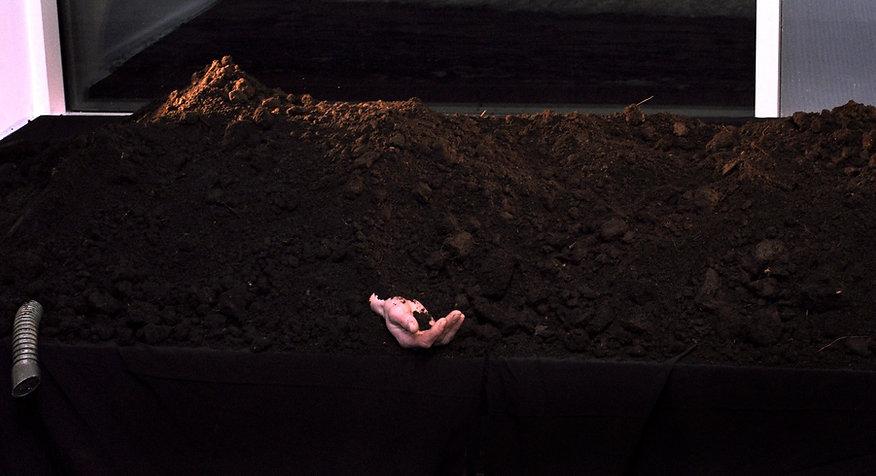 "Buried man. Performance ""Black Earth"""