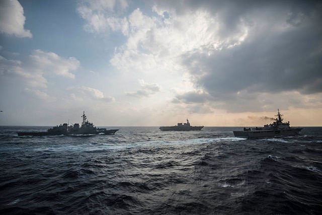 US Navy and Japan Maritime Self-Defense Force ships sail in formation during a joint/bilateral field training exercise on November 12, 2014. (Photo: Mass Communication Specialists 3rd Class Bradley J. Gee / US Navy)