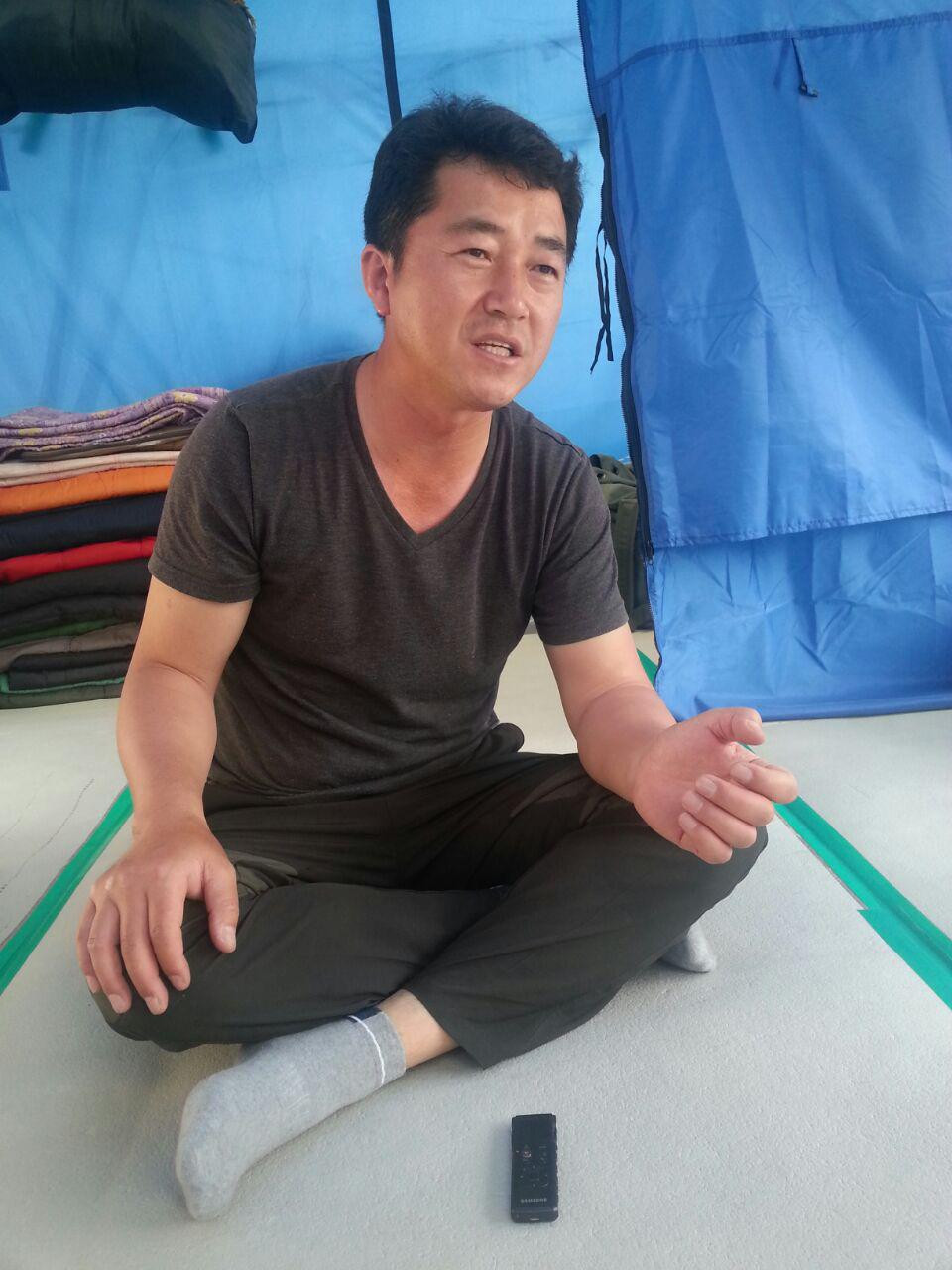 Kim Seung Seok in the Seoul City Plaza occupation tent.