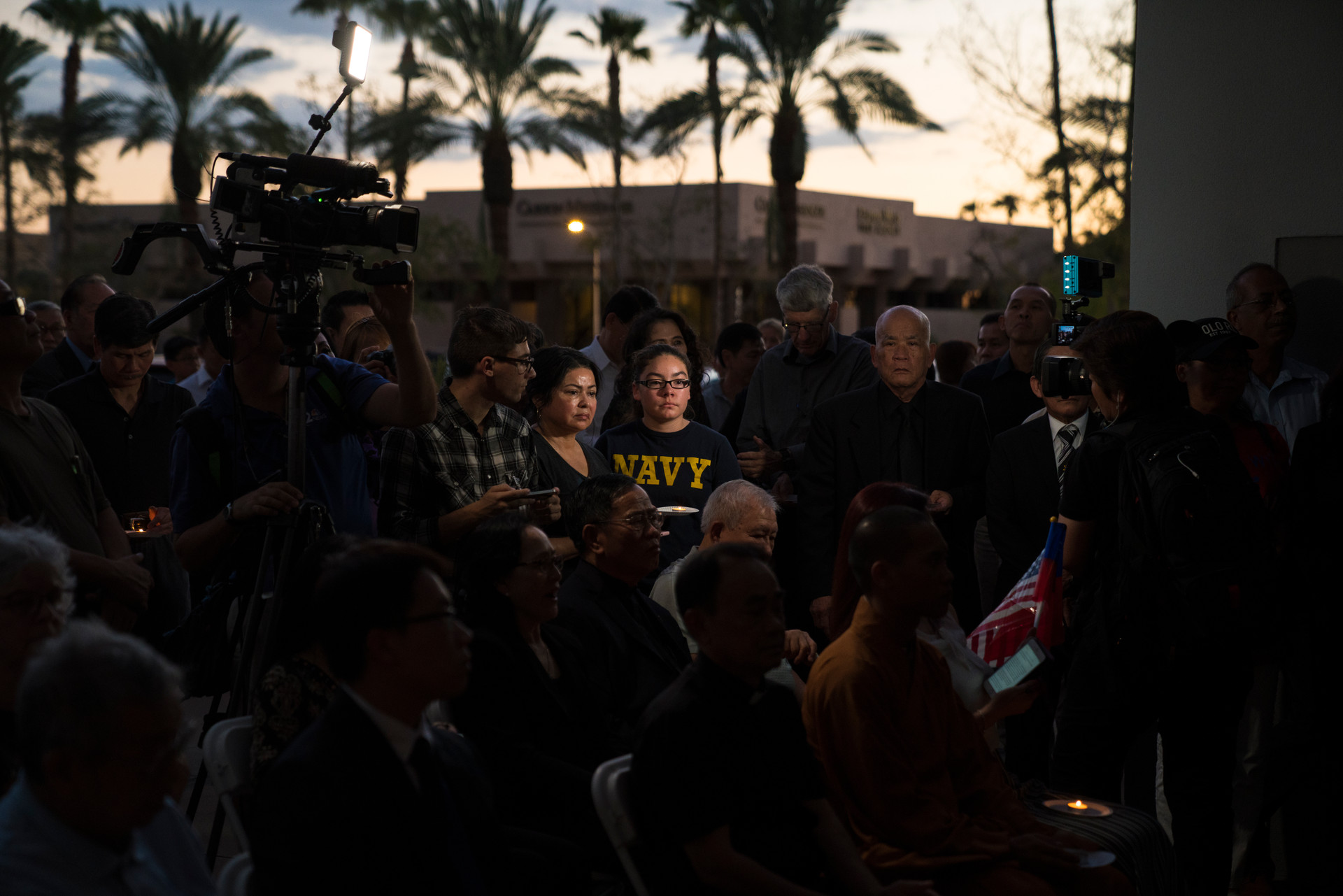 Ariona resdience attend the Vietnamese Association of Arizona memorial for John McCain at his office in Phoenix, Arizona on Sunday, August 26, 2018.