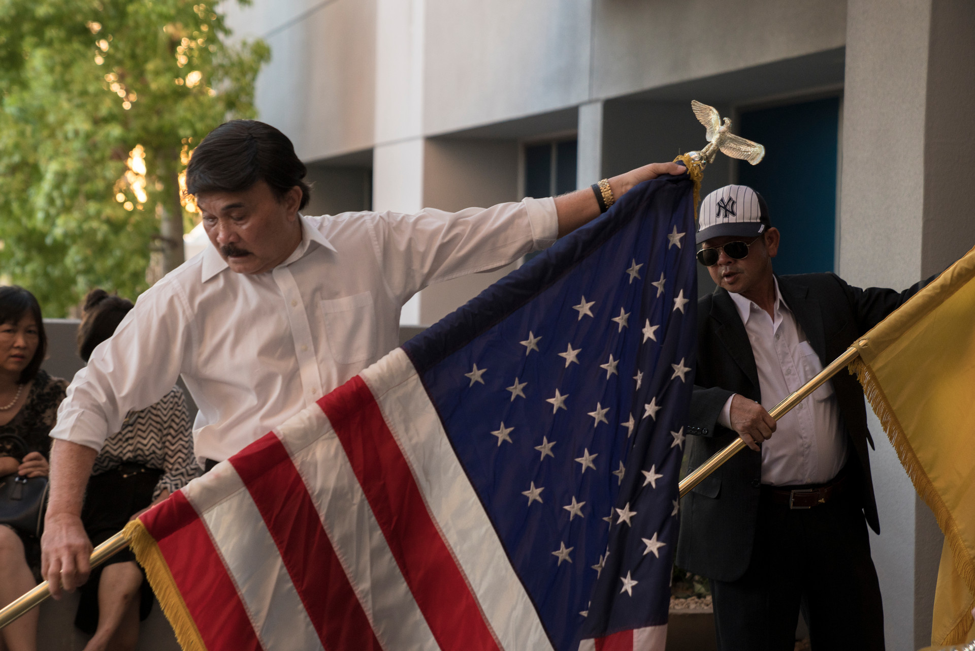 Vietnamese Association of Arizona members set up American and South Vietnemese flags for a memorial for John McCain at his office in Phoenix, Arizona on Sunday, August 26, 2018.