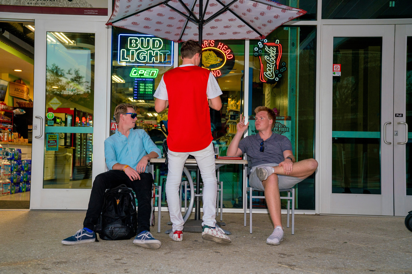 Jack Murphy and Jackson Parker speak with their client Brandon Stewart outside of the W6 in Tempe, AZ.