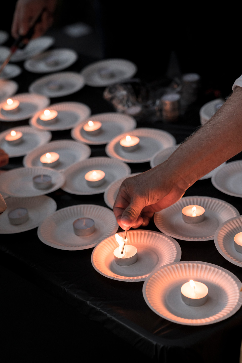 Vietnamese Association of Arizona members light candles for a memorial for John McCain at his office in Phoenix, Arizona on Sunday, August 26, 2018.