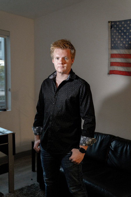 Jackson Parker, founder of Teteral Media stands in his apartment in Tempe, AZ.
