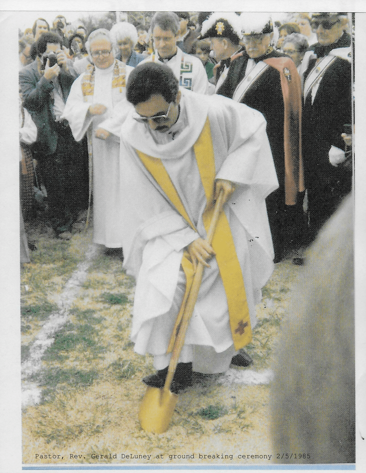 Pastor, Rev. Gerald DeLuney at ground breaking ceremony 2/5/1985