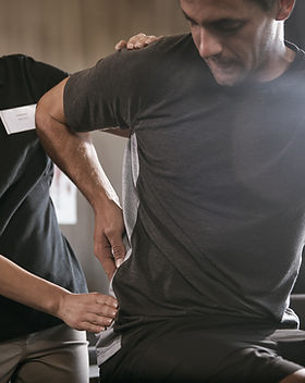 A Man Getting Soft Tissue Treatment For Back Pain