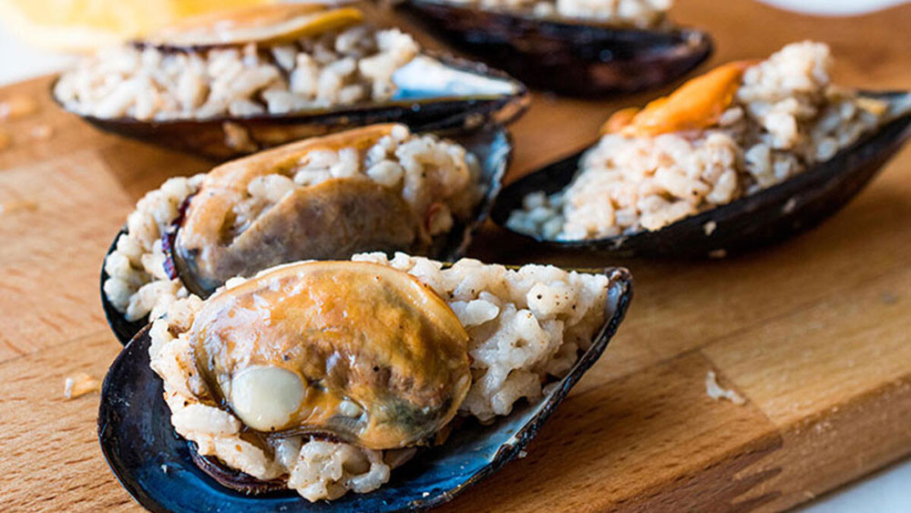 This popular Turkish street food consists of mussels that are stuffed with a blend of rice, herbs, spices, and nuts.