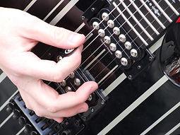 hand-playing-electric-guitar.jpg