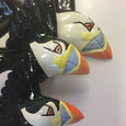 An Improbability of Puffins.  A Set of 3 Ceramic Wall Plaques.
