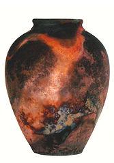 Copper fired raku pot.