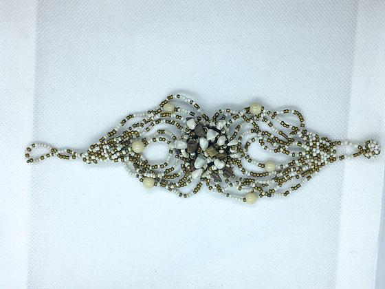 White and gold beaded bracelet