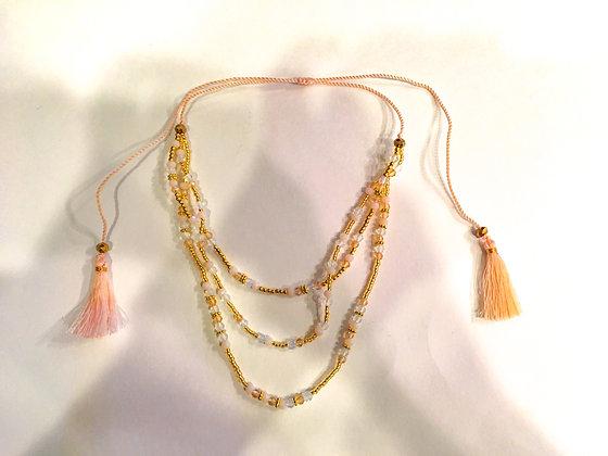 Multi strand light pink tassel necklace