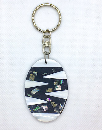 White zigzag oval shell keychain
