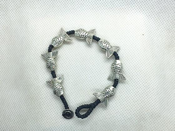 Flared tailed fish bracelet