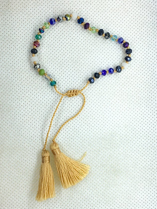 Adjustable tassel bracelet golden tan