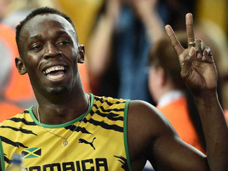 AWARDS AUCTION - Usain Bolt Signed T-Shirt!