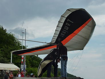 A Hang Glider Awaits to Take Off from Monte Grappa in Italy.