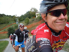 Bill's wagging tongue helping him get up the climb on a ride at Your Cycling Italia in Italy.