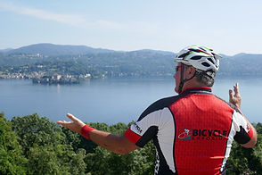 Bill Marengo of Bicycle Emporium showing off the views of lake Orta on a bike ride with Your Cycling Italia bicycle tours.