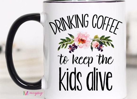 Drinking Coffee to Keep the Kids Alive Mug