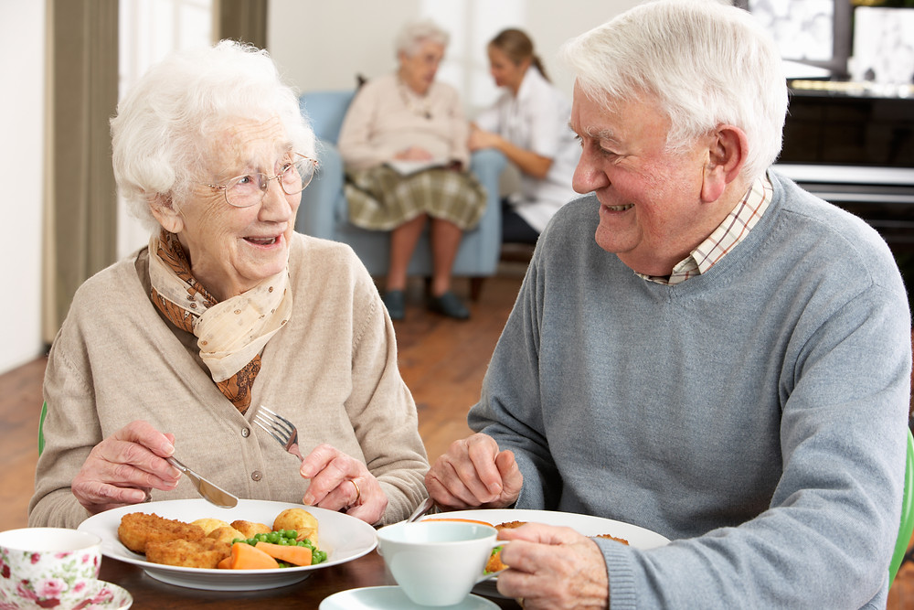 senior couple enjoying a dietitian consultant apporved meal
