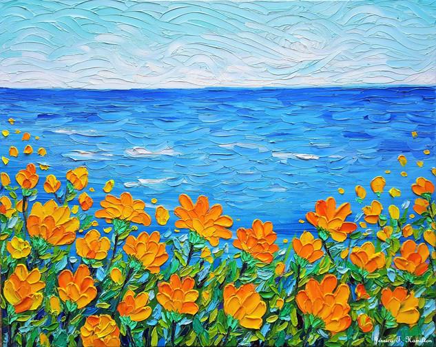 Orange flowers by the sea