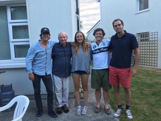 European volunteers with their English teacher, Vincent