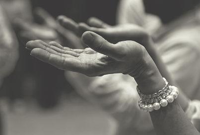 Hands held in upward prayer