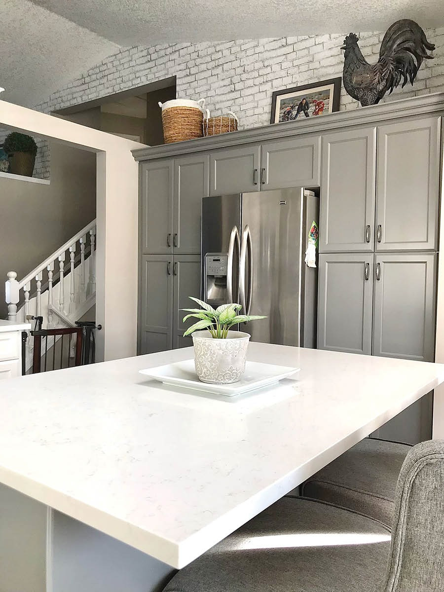 Modern Farmhouse Kitchen Makeover | Repainted Cabinets and Brick Wallpaper