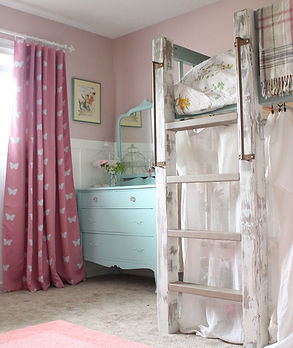 Pink accented children's bedroom.