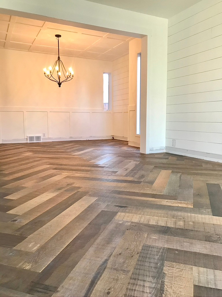 herringbone wood floors in dining room
