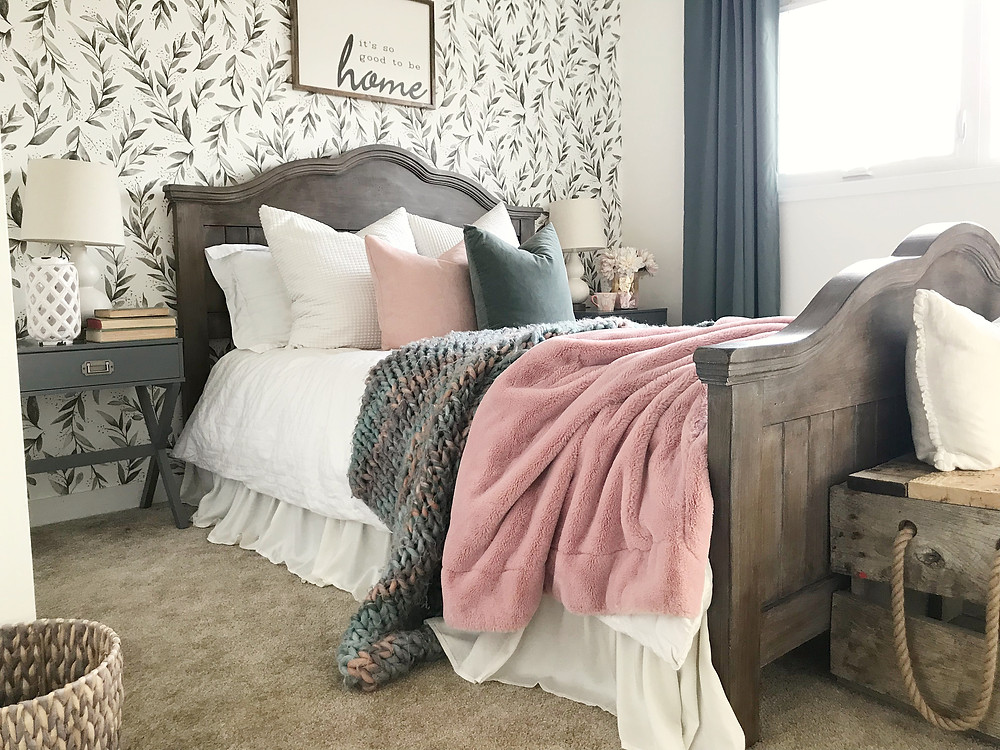 guestbedroom makeover with wallpaper and painted bedframe