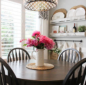 Farmhouse breakfast nook with pink flower accents.