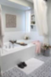 Master ensuite bathroom with large white tub.
