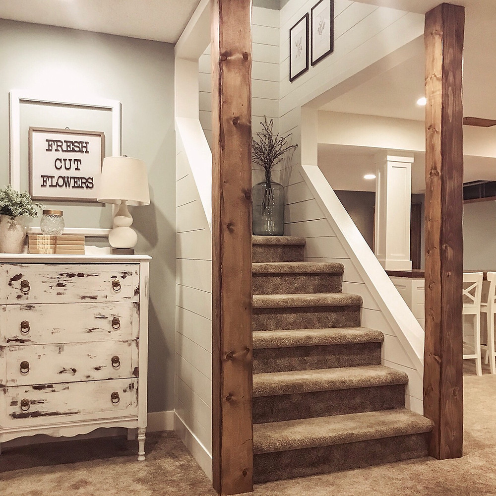 DIY rustic wood beams in a basement with shiplap