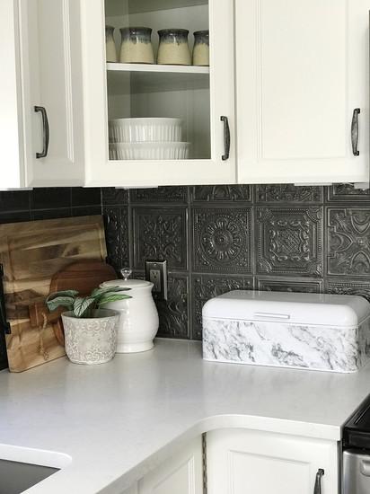 Unique backsplash for this farmhouse-style kitchen.