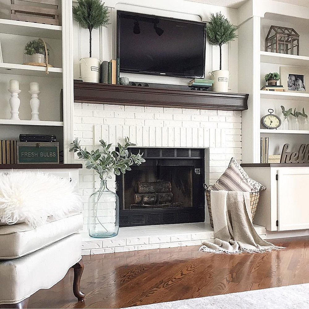 brick fireplace with built-ins painted out white
