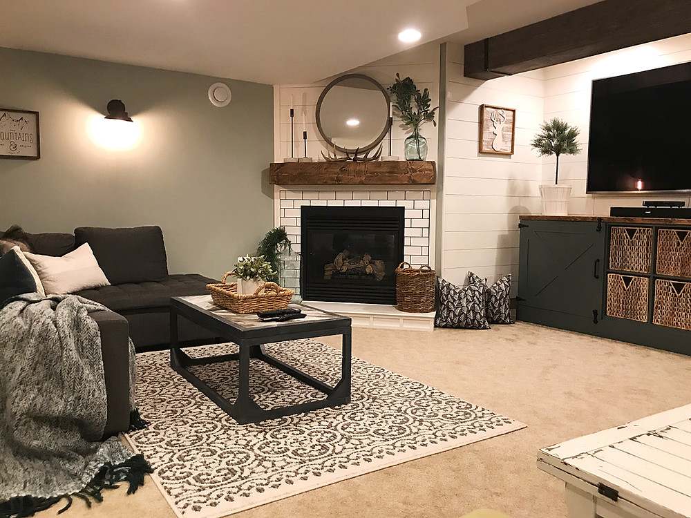 cozy basement family room with fireplace