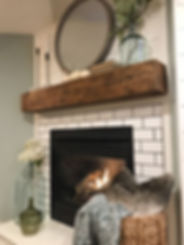 Fireplace wih mirror over the mantle.