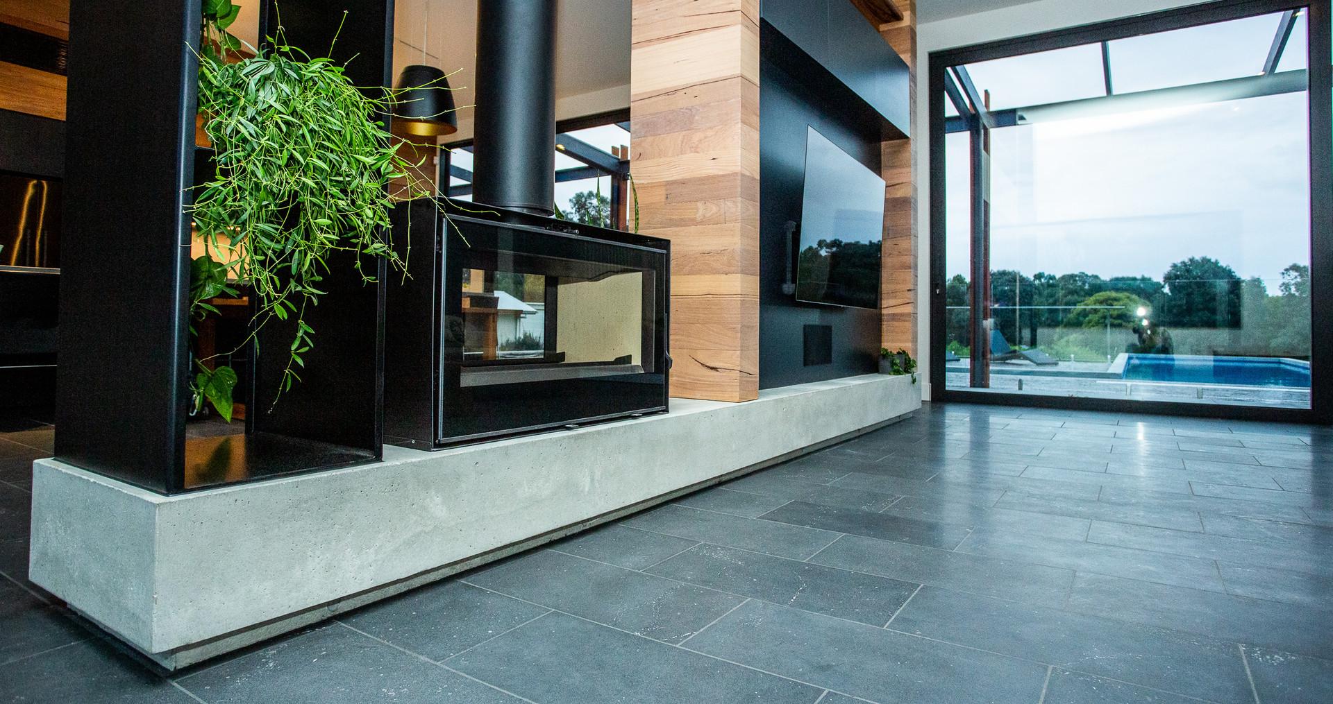 Concrete Fire Hearth Dividing Two Living Spaces