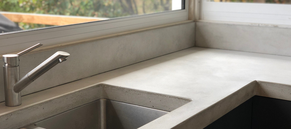Concrete Kitchen Bench with Concrete Splashback