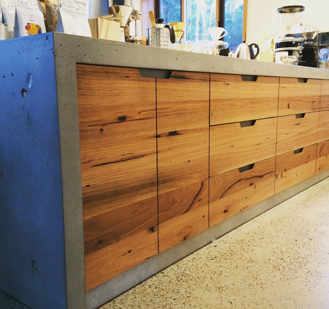 Concrete with Timber Cabinetry Kitchen Design