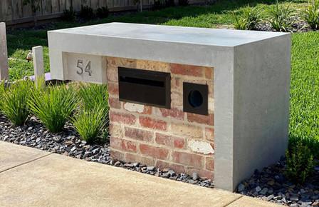 Concrete Letterbox with Red Bricks Design