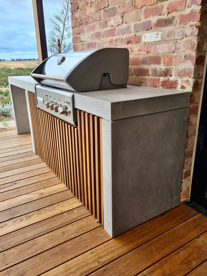 Outdoor Concrete Kitchen with Waterfall Ends and Timber Battens